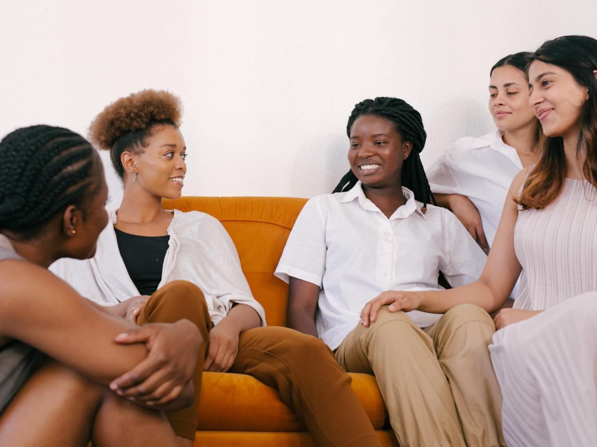Five ladies communicating